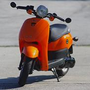 This scooter was a 50cc do-gooder before Mike gave it a custom GY6 kick in the pants.