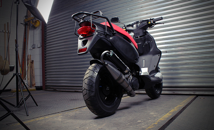 Sport tires and a race exhaust on a Genuine RoughHouse Scooter