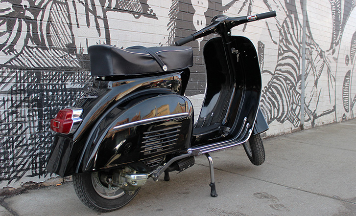Vespa Super, chilling out by a wall, looking all brand new